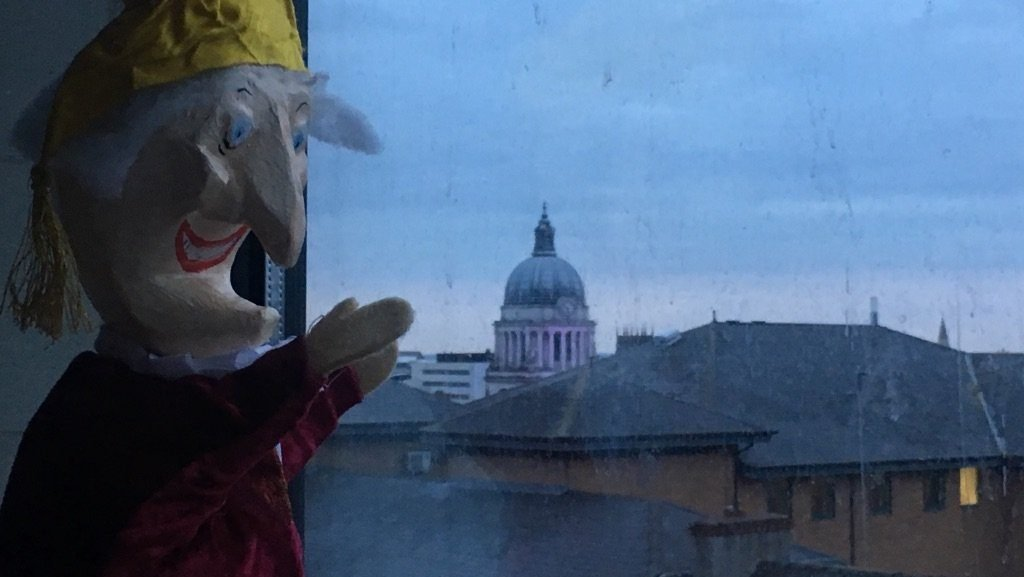 Punch puppet looking over skyline
