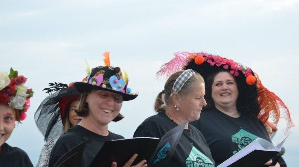 Singers in decorated hats