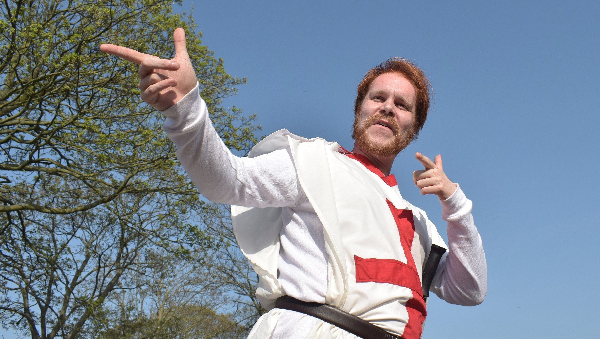 Ginger haired man wearing a knight's outfit and pointing - image by CJGriffiths