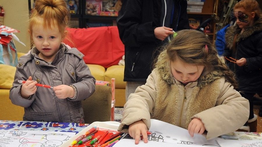 Two children colouring in